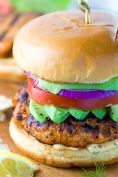 Salmon Burgers with Lemon Dill Sauce - You won't believe how simple and quick this fish recipe is! These grilled burgers are seasoned to perfection and they're a healthy alternative to meat. | jessicagavin.com