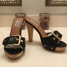 Steve Madden Crunk Adorable black Steve Madden Crunk slide with 1/2 inch platform and wooden heel.  Black leather upper with gold rivets and buckle.  Very good used condition. Steve Madden Shoes Heels