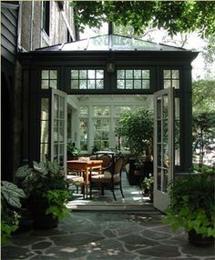 "love the ""beams"" in the walls- gives it character. Also love how the doors open onto patio!! Someday!!!"