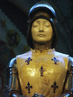 An amazing statue of, Joan of Arc. Symbolically decorated with French Fleur de lis. The statue is located at Notre-Dame de Reims Cathedral, Reims, France. ~ {cwlyons}