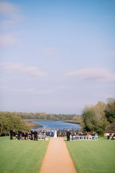Sweetgrass Social wedding at Middleton Place. Whitney & Trey. Ceremony space with a pond in the backdrop.