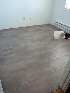 Kitchen floor idea TrafficMASTER Ceramica 12 in. x 24 in. Coastal Grey Vinyl Tile Flooring (30 sq. ft./case)