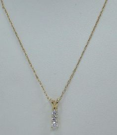 "10K YELLOW GOLD .53"" PENDANT .25 CTTW (3) DIAMOND 10K 19"" NECKLACE CHAIN 1.3g…"