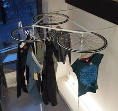 "Recycled bicycle wheels as clothes' hangers! | Repinned by Elite Sourcing, LLC | www.elitesourcingllc.com | A different kind of store fixture supplier: ""You need it, we'll find it."""