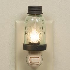 """The Mason Jar Night Light in Rustic Brown made with a mini mason jar. How cute! This Country Primitive Night Light is our most popular night light! - Dimensions: 1¾"""" x 5"""" with night light appliance -"""