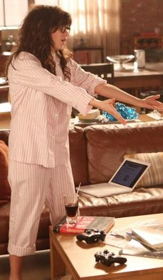 Zooey Deschanel's Pink striped pajamas on New Girl.  Outfit Details: http://wwzdw.com/z/2700/ #WWZDW