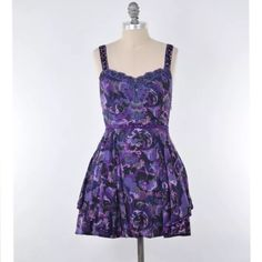 Free People beaded sequin fit & flare mini dress Gorgeous purple floral mini dress from Free People. Sweetheart neckline with slim, beaded and sequined straps. Slim waistline with matching beading. Fitted in the bust and waist with a gathered and flared skirt, creates a fit & flare silhouette. Cotton blend; lined. Size 4. * please no lowball offers Free People Dresses Mini