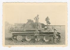Men of the American 12th Armored Division and a captured Tiger I, France 1944.
