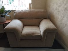 Very comfy, large armchair. Beige, herringbone pattern. In very good condition as it hasn't been use