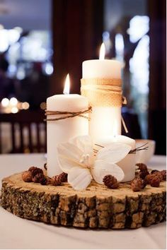 I am seeing this more and more....candles atop a tree ring. Also using the tree ring as a table charger!