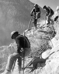 Jackhammer crews operating on Hungry Horse damsite abutment. Reclamation file photo. #TBT #throwbackthursday