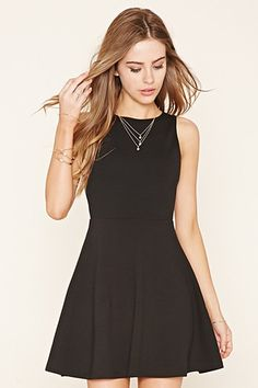 A sleeveless knit skater dress featuring a round neckline, a scoop back, and a flared skirt. Cheap Evening Dresses, Cheap Dresses, Cute Dresses, Grad Dresses, 21 Dresses, Party Dresses, Yellow Floral Dress, Little Dresses, Skater Dress