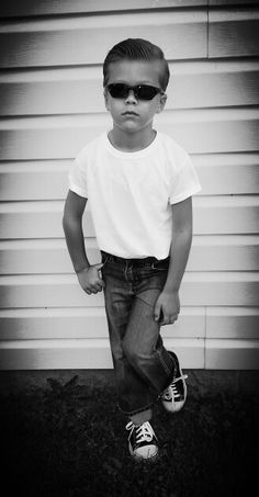 50 Days of Kindergarten - 50's Day. The only thing I had to buy were the sneakers (these are from Walmart). It will hold up better all day at school of you iron and starch the cuffs of the tshirt and pants. Also, don't forget to iron creases in the jeans. A boys 50's costume doesn't have to be expensive or elaborate, a few minor touches to items he already has will do the trick :)