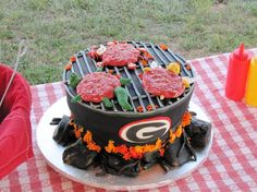 Tailgate cookout Cake! So cute! (: @Sarah Chintomby-Beth Tomberlin watcha think? Idk if Kelby likes Georgia football as much as you..