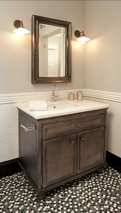 This is such a beautiful powder room with mosaic tile floor and tile wainscot with black tile base. #DesignPinThurs #TileSensations