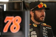 Martin Truex Jr., driver of the #78 Bass Pro Shops/Tracker Boats Toyota, stands in the garage area during practice for the Monster Energy NASCAR Cup Series Championship Ford EcoBoost 400 at Homestead-Miami Speedway on November 17, 2017 in Homestead, Florida.