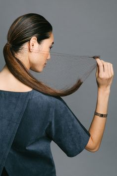 """Work Hair That Will Get You That Promotion Use the hairnet to catch your entire ponytail. Reyman calls this a """"hair hammock."""""""