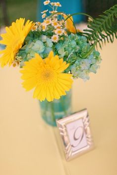 turquoise and yellow table setting.