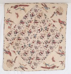 "Broderie Perse Fragment, c. 1800, 35"" x 35"", New England, created abt 1780-1800, large center block of early block print chintz; surrounded by chintz birds & butterflies, appliqued onto off-white homespun linen. Quilting in chevrons 1"" apart, 1/4"" separately applied binding (same fabric as center), backing of off white homespun"