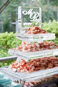 ice sculpture for raw bar---instead of using ice I like a glass window block - use glass etching gel on glass block you can keep...