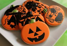 Kid-decorated cookies! Love this. Frost your pumpkin cookies with royal icing, allow to dry overnight (two days if humid) and let the kids draw on jack 'o' lantern faces with food coloring pens.