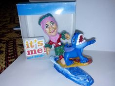 """here you go, she's surfing with her favorite character, """"Stich"""" from Disney"""