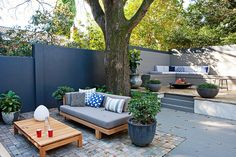 My Backyard, Outer Spaces! The texture of these Cobblestones define the lounge area of this garden oasis. Garden Vision Adam Robinson, Homes+ September Outdoor Areas, Outdoor Rooms, Outdoor Living, Outdoor Decor, Large Backyard, Backyard Patio, Brisbane, Melbourne, Sydney Gardens