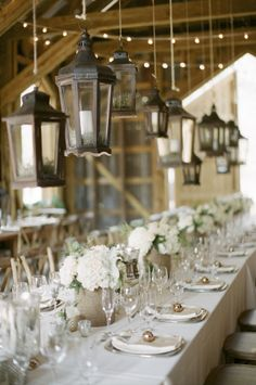 Hanging lanterns over the wedding tables | photography by http://www.ashleyseawellphotography.com