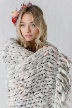 Pictured here is one of my favorite tassel knit throw patterns made with our Wanderlust or Flower Child yarn! It is so cozy and is the perfect gift!