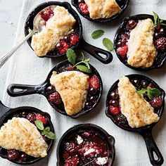 Mini Berry Cobblers    Use a mixture of blueberries, raspberries, blackberries, and strawberries in these charming individual desserts.  tastofhome.com