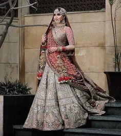 This gorgeous punjabi bride serving some serious royalty goals! The jewellery, the stunning outfit, the tassled kaleeras- we are… Designer Bridal Lehenga, Indian Bridal Lehenga, Indian Bridal Outfits, Indian Bridal Fashion, Indian Bridal Wear, Indian Dresses, Lehenga Wedding, Indian Wear, Punjabi Bride
