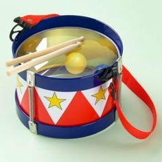 : Tin Drum by Land of Nod. $16.95. Kids tin drum. Includes two wooden drum sticks and adjustable/removable strap. For ages 3 and up.