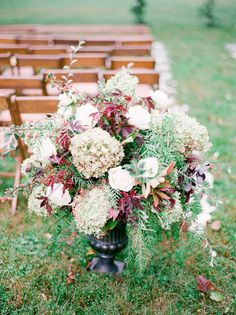 Wedding ceremony aisle flowers floral arrangement by Sweet Root Village aisle marker    Virginia Countryside Fall Wedding by East Made Event Company fine art destination wedding planner and Julie Paisley Photography as featured on Style Me Pretty