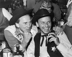 Kirk Douglas and Frank Sinatra having a laugh at a Share Inc. Boom Town Party, 1959