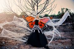 Kandylane Enchanted: The Enchanted Escape (#14, #15, #16, #17)halloween costume homemade monarch butterfly wings skirt women trapped in spider web manic panic gothic white pale foundation fairy orange costume makeup orange lips dramatic orange makeup fashion corset shop fashion glamour fine art photography, photography, enchanted photography, whimsical jamberry nails custom nail wraps photographer and designer Kira Sanoja Makeup artist brittany benko Model shelsi stolworthy cancer battle