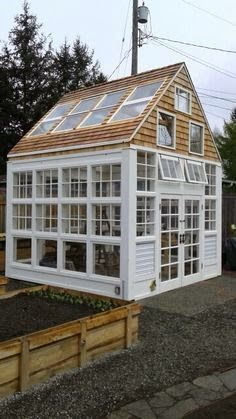 Super cool greenhouse made from upcycled windows and materials.