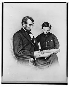 Lincoln and Tad enjoy a book.