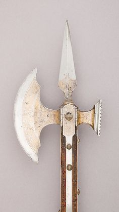 War Axe Date: ca. 1475 Geography: Venice Culture: Italy, Venice Medium: Steel, wood, iron, brass, textile, gold Dimensions: L. 85 in. (225.9 cm); L. of head 13 in. (33 cm); W. 7 3/4 in. (19.7 cm); Wt. 6 lbs. 7 oz. (2920 g)