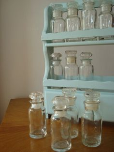 Vintage spice rack, with a new coat of aqua paint and 12 great vintage glass bottles. Bottles would also make great bud vases! Bottles And Jars, Glass Bottles, Perfume Bottles, Vintage Farm, Vintage Kitchen, White Furniture, Painted Furniture, Aqua Paint, Spice Organization