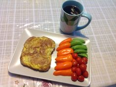 12-grain slice dipped in two whole eggs with a pinch of salt, pepper and oregano.  Hearty vegetables - orange pepper, grape tomatoes and sugar snap peas. 1 large cup of sage tea. Yum!