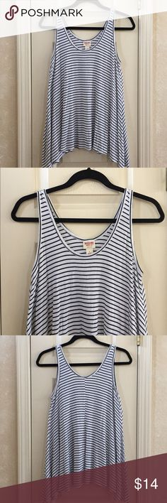 Ribbed Tank Top Black and white striped tank top. Ribbed material. 96% rayon, 4% spandex. Mossimo Supply Co. Tops Tank Tops