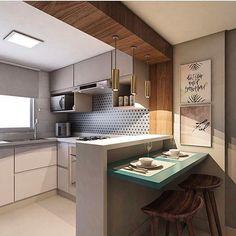 Cozinha americana lindaaaa!!! Adorei o detalhes de madeira que revê-te a viga e destaca os pendentes sobre a bancada.