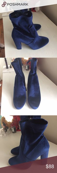 Blue velvet chunky heel boots Very cute Steve Madden shoes that I bought in Times Square. They unfortunately were too high for me but they're so cute I can't let them go to waste. The fabric is cute and the ankle part is comfortable and stretchy. I wore them once for five minutes and realized they are too high. Need someone to take them off my hands! There is a slightly damaged part at the back of one heel that's unnoticeable. Could be from box, not sure. Steve Madden Shoes Ankle Boots…