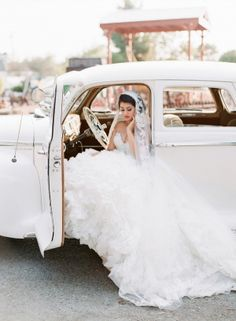 love the vintage wheels and her veil.