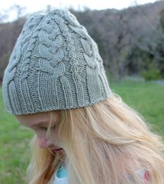 I love spring mornings and evenings in the mountains...they're a little cool, still, so my girl wears a 100% wool handknit beanie. With cables, to make it special.