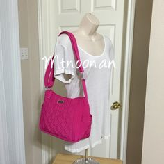 """Vera Bradley On The Go Crossbody in Fuchsia Pink NEW WITH TAGS 100% Authentic Vera Bradley """"On The Go"""" Purse in Fuchsia. Can be worn as a Crossbody or a shoulder bag!  • Dimensions: 11.5"""" x 8.5"""" x 4.25"""" with 53"""" adjustable strap  • Exterior: Side slip pockets and a large zippered pocket on back • Interior: Three slip pockets and one zip inside • Sleek silhouette and silver logo hardware • MSRP $88.00   I have more VERA BRADLEY, Check out my other items!  ❌ NO TRADES  FOLLOW ME ON INSTAGRAM…"""