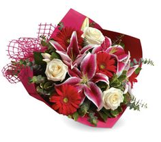 """Buy """"Stolen Kisses"""" for $79.95. Show Someone How Much You Love Them With This Gorgeous Bouquet Of Lilies, Roses And Gerberas.  Flowers Are Subject To Seasonal Availability. In The Event That Any Of The Flowers Are Unavailable, The Florist Will Substitute With A Similar Flower In The Same Shape, Style And Colour. Stem Count, Packaging And Container May Vary. Standard (pictured Price) : B26"""
