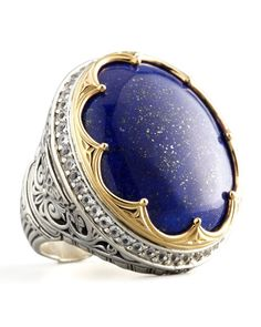 "Round Topaz-Bezel Lapis Ring This statement-making Konstantino ring highlights the qualities of the woman who wears it—refined, lovely, and luminous. You'll love how the electric blue lapis provides the perfect pop of color. Round, variegated blue lapis center. Pave white topaz bezel. Carved sterling silver settings and band. 18-karat yellow gold scallops. 1 1/4""L x 1""W. Handcrafted in Athens, Greece."