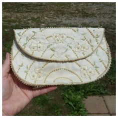 Check out this item in my Etsy shop https://www.etsy.com/listing/275206472/vintage-white-silk-pearl-beaded-clutch