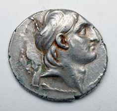 Large silver tetradrachm with bust of Demetrius I on front, Tyche seated on reverse holding cornucopia. Ca 162 to 150 BCE.